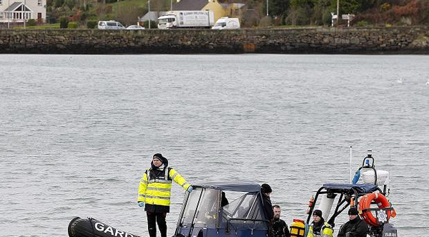 The land, sea and air search for two fishermen who have been missing since their trawler sank nearly three weeks ago is to be wound down