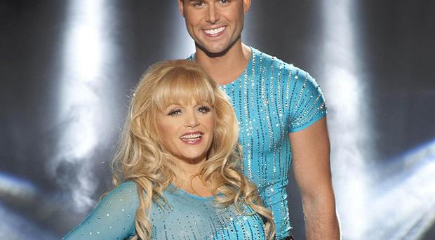 Dallas Star Charlene Tilton and her pro skating partner Matt Gonzalez have been voted off Dancing on Ice (ITV/PA)
