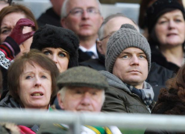 Ireland's injured captain Brian O'Driscoll watches the match with his wife Amy Huberman
