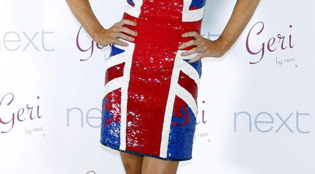 True colour: Geri's dress may divide opinion here|