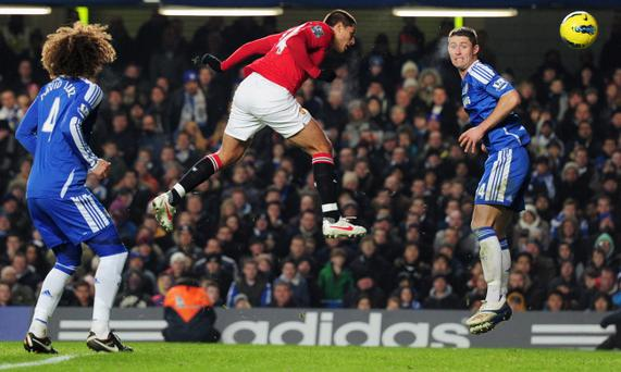 LONDON, ENGLAND - FEBRUARY 05: Gary Cahill of Chelsea (R) fails to stop Javier Hernandez of Manchester United (C) scoring their third goal with a header during the Barclays Premier League match between Chelsea and Manchester United at Stamford Bridge on February 5, 2012 in London, England. (Photo by Shaun Botterill/Getty Images)