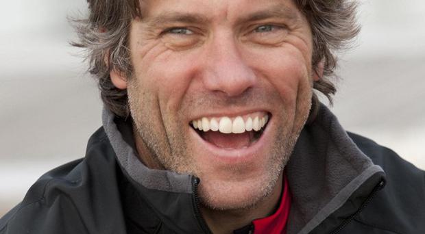 Comedian John Bishop will undertake a gruelling triathlon for charity