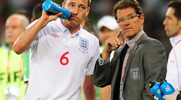 England coach Fabio Capello (right) has spoken out in defence of axed skipper John Terry