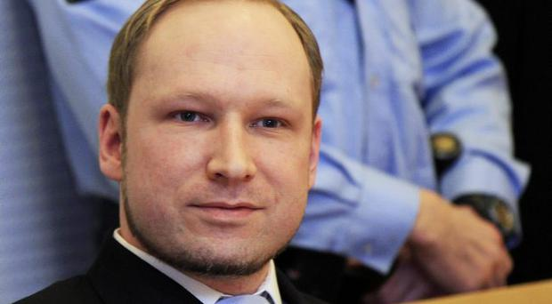 Anders Behring Breivik arrives for a detention hearing at a court in Oslo, Norway, Monday, Feb. 6, 2012