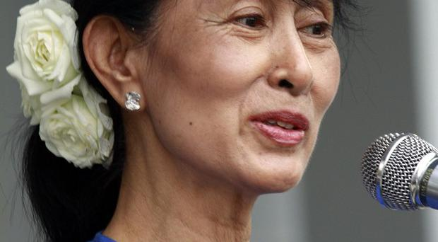 Aung San Suu Kyi is free to run for parliamentary by-elections in April after Burma's election commission accepted her candidacy (AP)