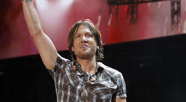 Keith Urban has had a polyp removed from a vocal chord