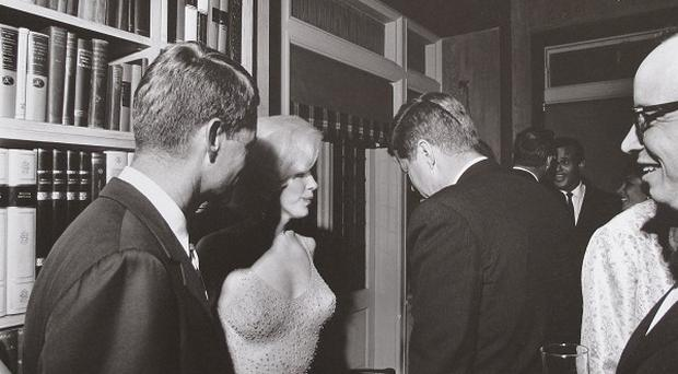 A rare image of Marilyn Monroe with John F Kennedy and Robert Kennedy