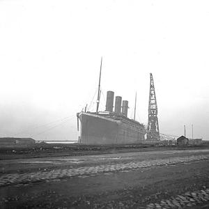 Titanic at fitting-out wharf with three out of four funnels fitted. Photograph © National Museums Northern Ireland. Collection Ulster Folk & Transport Museum