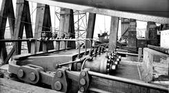 Titanic. Hydraulic launch rams below port bow. Photograph © National Museums Northern Ireland. Collection Harland & Wolff, Ulster Folk & Transport Museum