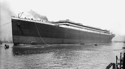 Titanic. Port bow 3/4 profile afloat immediately after launch. Photograph © National Museums Northern Ireland. Collection Harland & Wolff, Ulster Folk & Transport Museum