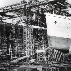 The Titanic being built in Belfast. Photograph © National Museums Northern Ireland. Collection Harland & Wolff, Ulster Folk & Transport Museum
