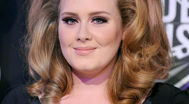 Adele and other British acts took a big chunk of album sales in 2011