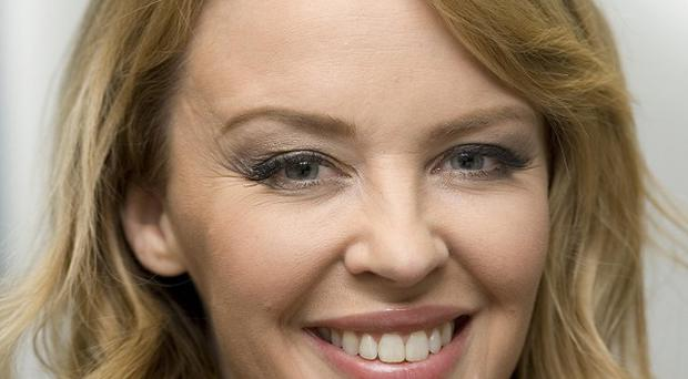 Singer Kylie Minogue told fans she was targeted by an online stalker