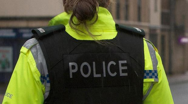 Police are appealing for witnesses after a cash-in-transit robbery in west Belfast