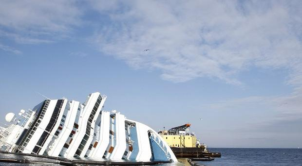 The captain of the sunken Costa Concordia has lost his attempt to be freed from house arrest (AP)