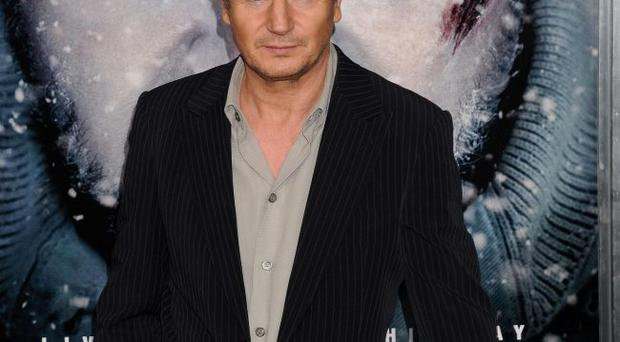 Biting back: Liam Neeson has been criticised for eating wolf stew