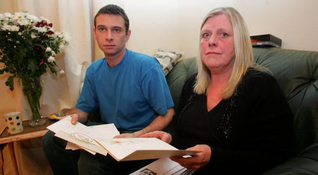 Jeanette Ervine & Son Mark Look over the Many Sympathey & Mass Cards sent to their home following the Death of David Ervine.
