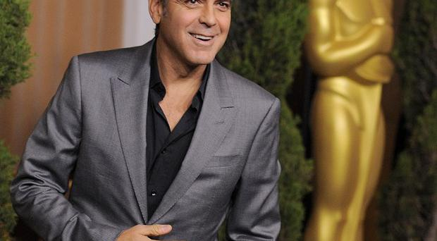 George Clooney has joked that he would like to adopt co-star Shailene Woodley
