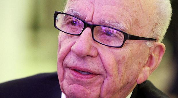 Investigations surrounding the closure of News of the World cost Rupert Murdoch's News Corp 55 million pounds in the final three months in 2011