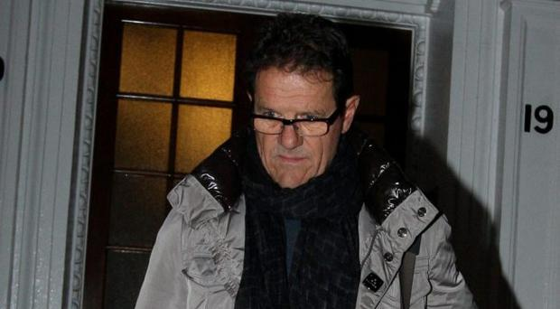 Fabio Capello leaves his Central London home with luggage following his resignation as England Manager.