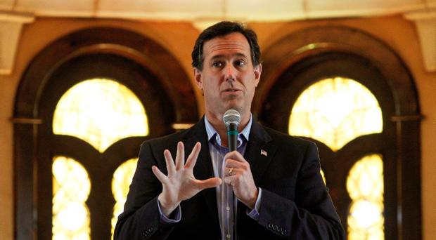 Republican presidential candidate, former U.S. Sen. Rick Santorum talks with supporters during a campaign event held at the Bella Donna Chapel on February 8, 2012 in McKinney, Texas.