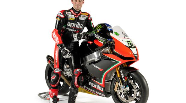 Eugene Laverty with his new 2012 Aprilia at Milan launch yesterday