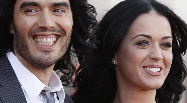 Russell Brand and Katy Perry will be officially divorced on July 14 (AP/Joel Ryan, file)