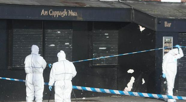 Forensic officers at the scene of the shooting in the Finglas area of north Dublin