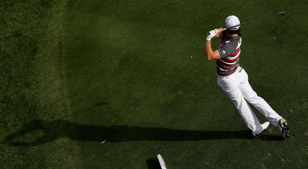 DUBAI, UNITED ARAB EMIRATES - FEBRUARY 09: Rory McIlroy of Northern Ireland hits his tee-shot on the 17th hole during the first round of the Omega Dubai Desert Classic at the Emirates Golf Club on February 9, 2012 in Dubai, United Arab Emirates. (Photo by Andrew Redington/Getty Images)