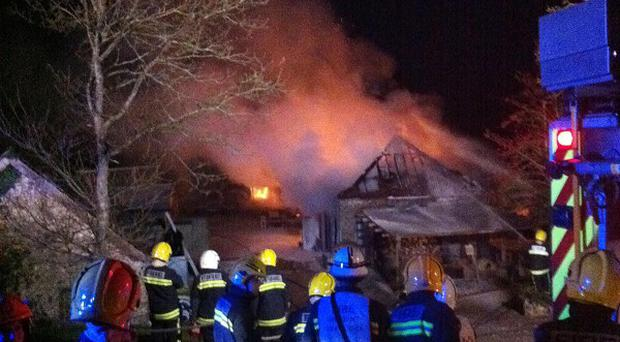 Firefighters tackle a blaze at Hugh Fearnley-Whittingstall's River Cottage Park Farm