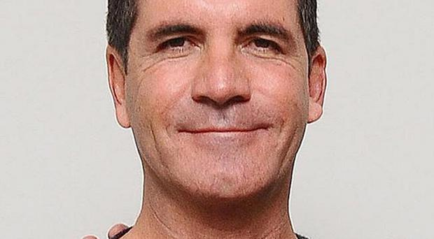Simon Cowell thinks Katy Perry or Madonna would be great as X Factor judges