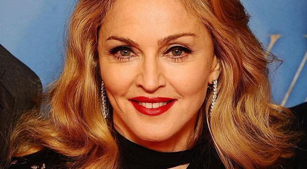 Police are hunting a man convicted of threatening to kill Madonna