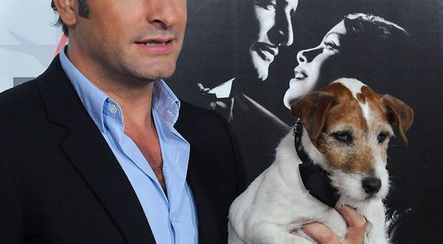 Uggie the dog, seen with co-star Jean Dujardin, has won an award for The Artist