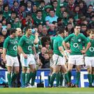 Losing it: dejected Irish rugby players after losing the match against Wales which saw an inverse tackle by Bradley Davies