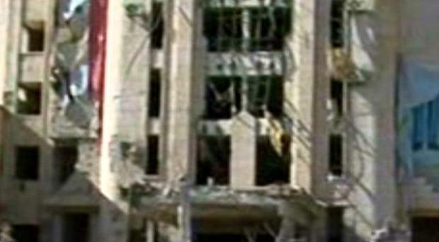 A Syrian security compound building damaged in the blasts in Aleppo.