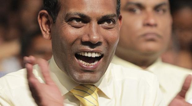 Former Maldives President Mohamed Nasheed claims he was ousted from power in a coup that sparked rioting earlier this week (AP)