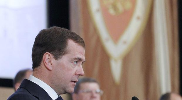 Russian President Dmitry Medvedev speaking at a meeting with top officials of the Federal Security Service (FSB) in Moscow(AP)
