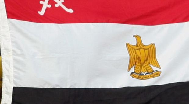A British woman has been barred from leaving Egypt amid an investigation into unrest in the country