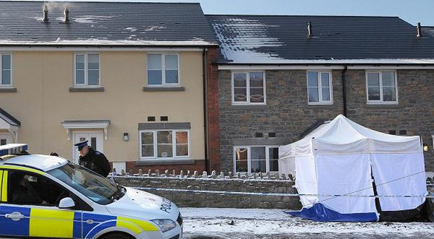 The scene outside an address on Woodgate Road in the Mile End area of Coleford where a man was fatally stabbed