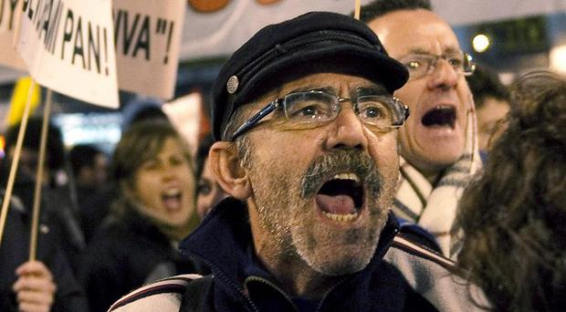 In Madrid a protester shouts during a protest against labour market reforms (AP/Pedro Acosta)