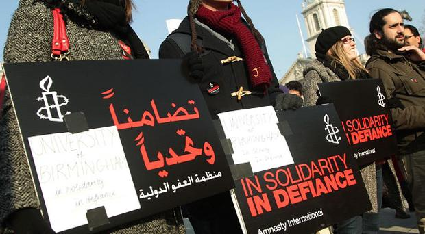 People gather in Trafalgar Square for a day of action to show support for peaceful protests across the Middle East and North Africa, organised by Amnesty International