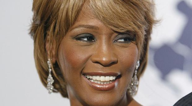 Whitney Houston has died aged 48 (AP/Matt Sayles)
