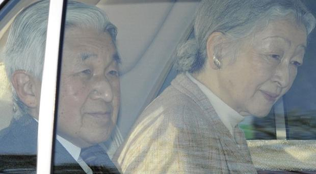 Japan's Emperor Akihito, along with Empress Michiko, heads to the University of Tokyo Hospital (AP)