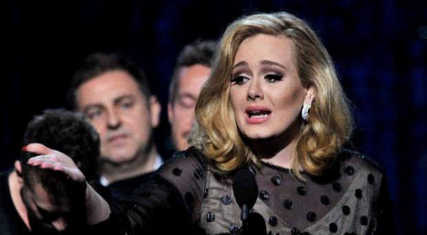 Singer Adele accepts the award for 'Album of the Year' onstage at the 54th Annual GRAMMY Awards held at Staples Center on February 12, 2012 in Los Angeles, California.