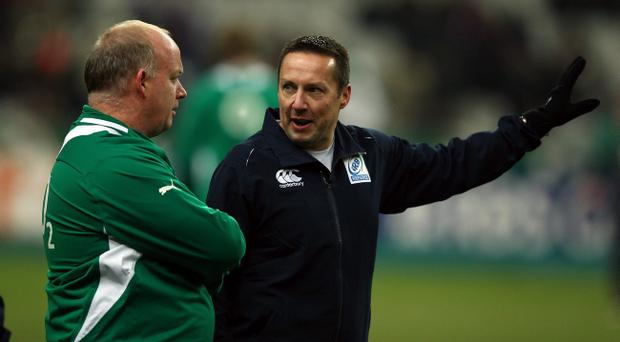Referee Dave Pearson speaks Ireland coach Declan Kidney as the match is called off just before kick off due to a frozen pitch during the RBS 6 Nations match between France and Ireland at Stade de France on February 11, 2012 in Paris, France