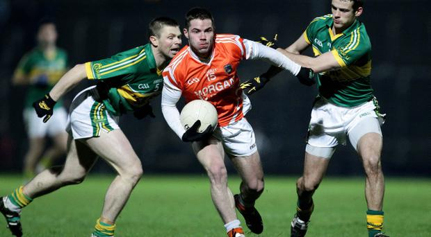 Kerry's Tomas O'Se and Shane Enright tackle Eugene McVerry of Armagh