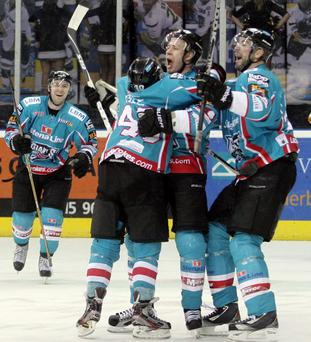 Kuiper hero: Belfast Giants players rush to celebrate with Nick Kuiper after his game winning goal