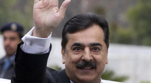 Pakistani prime minister Yousuf Raza Gilani arrives at the Supreme Court for a hearing in Islamabad, Pakistan (AP/Anjum Naveed)