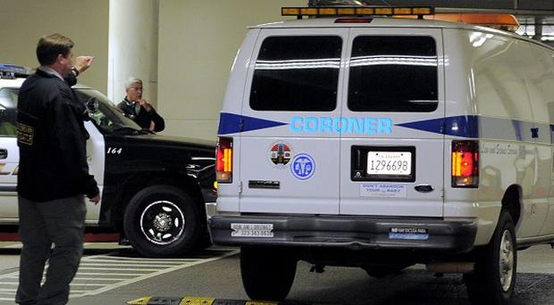 A coroner's van at the Beverly Hilton Hotel where Whitney Houston was found dead (AP)