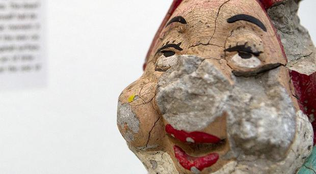 A shattered gardengnome, one of the exhibits at the Museum of Broken Relationships (AP)